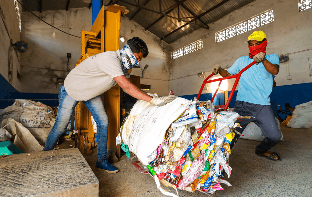 two Carpe workers recycle plastic